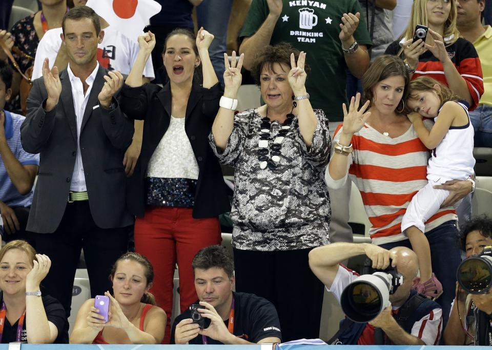 Debbie Phelps, center, the mother of United States' Michael Phelps celebrates after he won gold in the men's 200-meter individual medley swimming final at the Aquatics Centre in the Olympic Park during the 2012 Summer Olympics in London, Thursday, Aug. 2, 2012. (AP Photo/Lee Jin-man)