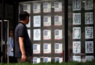 A Chinese man checks out the property prices at a real estate agency in Beijing. Fewer Chinese cities reported rises in home prices in September than the previous month, official data showed Thursday, as the government stood by its stance of controlling property speculation