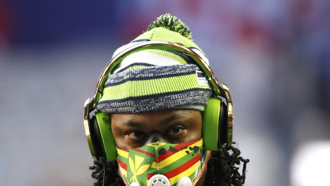 Seattle Seahawks running back Marshawn Lynch wears a mask during warm-ups befire the start of the NFL Super Bowl XLIX football game against the New England Patriots in Glendale