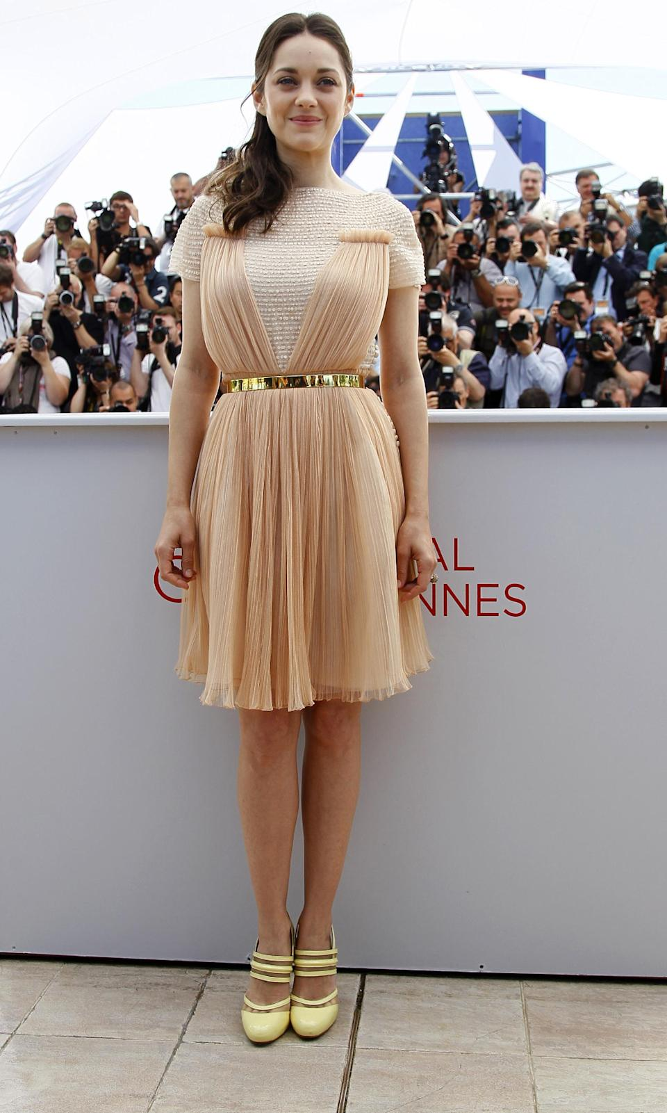 Actress Marion Cotillard poses during a photo call for Rust and Bone at the 65th international film festival, in Cannes, southern France, Thursday, May 17, 2012. Cotillard is wearing Dior. (AP Photo/Francois Mori)
