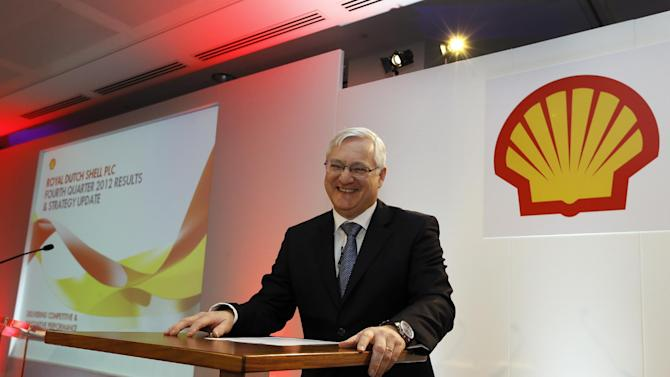 Peter Voser, Chief Executive Officer of Shell, smiles as he poses for a picture ahead of the Royal Dutch Shell's full year results 2012 press conference, in London, Thursday, Jan. 31, 2013. (AP Photo/Kirsty Wigglesworth)