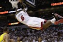 Miami Heat forward LeBron James (6) hangs from the basket after dunking the ball during the second half of Game 2 in their NBA basketball Eastern Conference finals playoff series against the Indiana Pacers, Friday, May 24, 2013, in Miami. (AP Photo/Lynne Sladky)