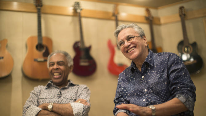 Brazilian singers Gilberto Gil, left, and Caetano Veloso give an interview at a recording studio in Rio de Janeiro, Brazil, Wednesday, May 27, 2015. As close as brothers, the two have helped one another make the most of the limelight since meeting in 1963 in the colonial city of Salvador, coming together periodically to write songs, produce one another's albums or perform. The two 72-year-olds are continuing that relationship with a joint tour of 10 European countries from June 25 to Aug. 2. (AP Photo/Felipe Dana)