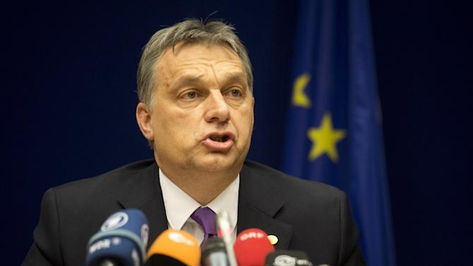 Hungary's Prime Minister Viktor Orban speaks during a media conference at an EU summit in Brussels on Thursday, March 14, 2013. European Union heads of state and government meet for a two-day summit, beginning Thursday, to discuss the current financial crisis. (AP Photo/Geert Vanden Wijngaert)