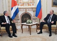 Russia's President Vladimir Putin (R) speaks with visiting Cuban leader Raul Castro as they meet in the Novo-Ogaryovo residence outside Moscow. Castro sought on Wednesday to revive an historic but flagging friendship with Russia as he met Putin for talks on economic relief for his sanctions-plagued communist state
