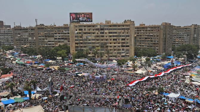 """Supporters of Egypt's ousted President Mohammed Morsi offer their Friday prayer in Nasr City, Cairo, Egypt, Friday, July 12, 2013. Thousands of supporters of Egypt's Muslim Brotherhood group rallied in a Cairo city square, waving pictures of the ousted president and chanting anti-military slogans, deriding army chief who led Morsi's removal as """"traitor"""" with one ultraconservative Salafi cleric vows to stay in the streets for years until Morsi is reinstated. (AP Photo/Hussein Malla)"""
