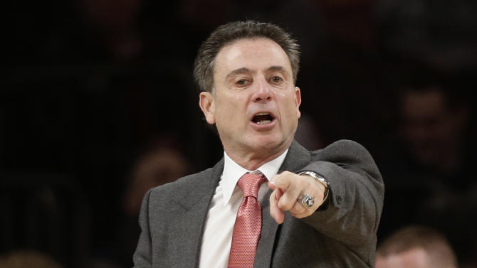 Louisville head coach Rick Pitino calls to his team during the first half of an NCAA college basketball game against Notre Dame at the Big East Conference tournament on Friday, March 15, 2013, in New York. (AP Photo/Frank Franklin II)
