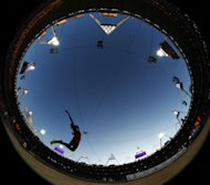 In this photo taken with a fisheye lens, United States' Brittney Reese competes in a women's long jump final during the athletics in the Olympic Stadium at the 2012 Summer Olympics, London, Wednesday, Aug. 8, 2012. (AP Photo/Matt Dunham)