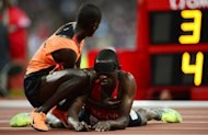 Kenya's Samwel Mushai Kimani (R) is assited by his guide James Boit after winning the men's T11 1500m and breaking the world record at the Paralympic Games at the Olympic Park in east London, England, on September 3, 2012. Athletes at the London Paralympics are on course to break more world records than in Beijing four years ago, the International Paralympic Committee (IPC) said on Tuesday