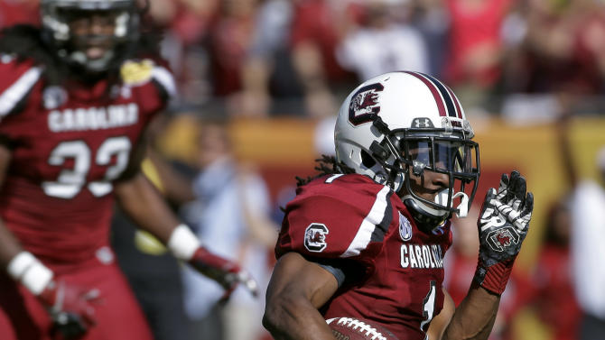 South Carolina's Ace Sanders (1) runs back a punt 63-yards for a touchdown against Michigan during the first quarter of the Outback Bowl NCAA college football game,  Tuesday, Jan. 1, 2013, in Tampa, Fla. (AP Photo/Chris O'Meara)