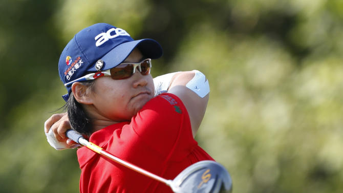 Yani Tseng, of Taiwan, watches her tee shot on the tenth tee during the second round of the U.S. Women's Open golf tournament on Friday, July 6, 2012, in Kohler, Wis. (AP Photo/Jeffrey Phelps)