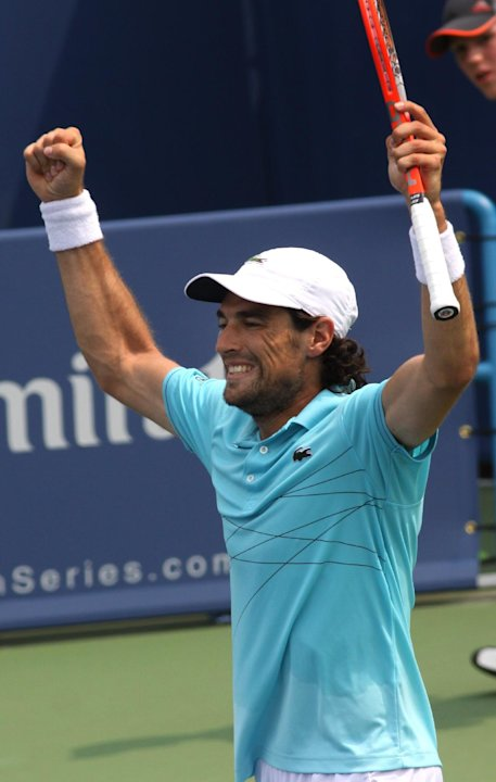 Jeremy Chardy, of France, reacts after beating Andy Murray, of Great Britain, 6-4, 6-4, in the Western &amp; Southern Open tennis tournament, Thursday Aug. 16, 2012, in Mason, Ohio. (AP Photo/Tom Uhlman)