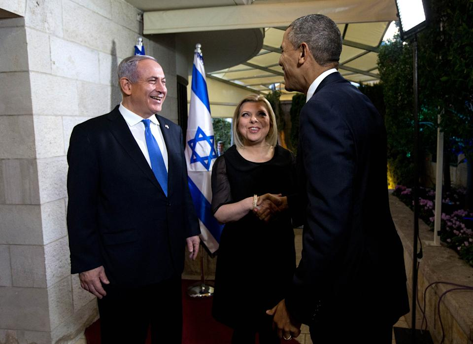President Barack Obama is greeted by Israeli Prime Minister Benjamin Netanyahu and his wife, Sara,  at his residence in Tel Aviv, Israel, Wednesday, March 20, 2013.  (AP Photo/The New York Times, Doug Mills, Pool)