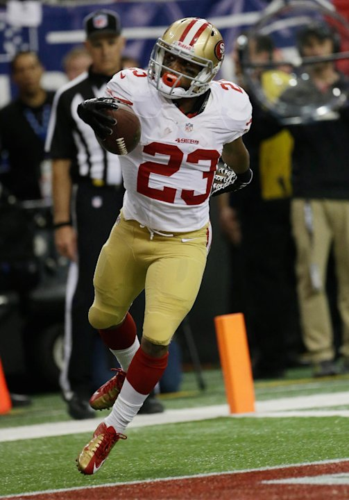 San Francisco 49ers' LaMichael James celebrates after rushing 15-yards for a touchdown during the first half of the NFL football NFC Championship game against the Atlanta Falcons Sunday, Jan. 20, 2013