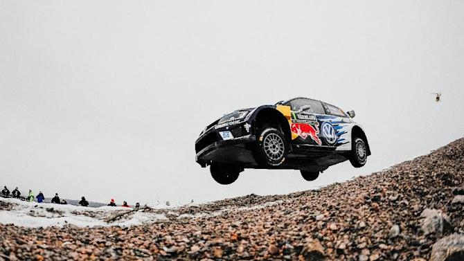 Sebastien Ogier of France and his co-driver Julien Ingrassia steer their Volkswagen Polo during the 2nd stage of the Rally Sweden, second round of the FIA World Rally Championship on February 12, 2016 in Torsby, Sweden