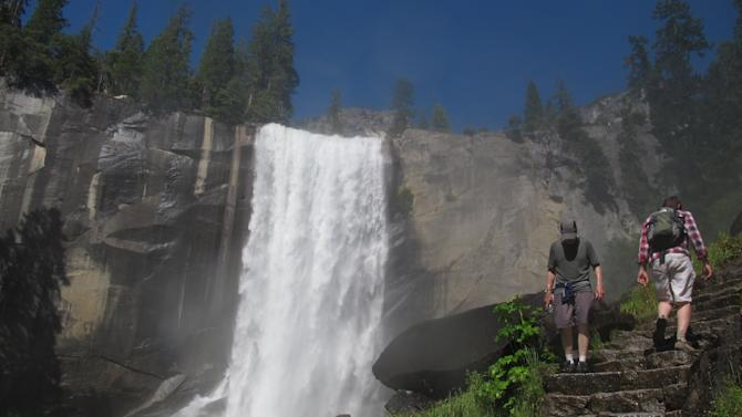 Hikers on the Mist Trail to Vernal Fall in Yosemite are seen Wednesday July 20, 2011. A man and a woman crossed a metal barricade above the 317-foot Vernal Fall on Tuesday, making their way over slick granite to a rock on the edge of the swift Merced River trying to pose for a picture. Instead they burned a horrifying image into the memories of everyone who saw.  (AP Photo/GosiaWozniacka)