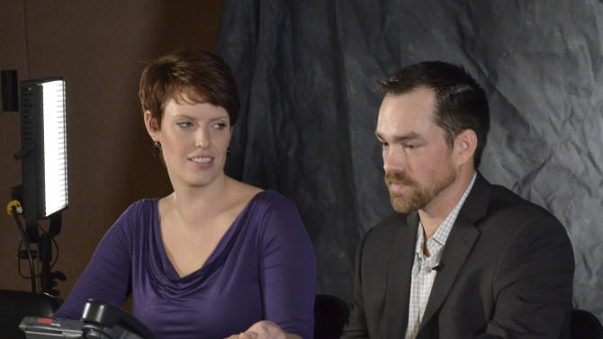 FILE - In this Jan. 16, 2013 file photo Clint Romesha, a North Dakota veteran set to receive the Medal of Honor for courageous action during a 13-hour firefight in Afghanistan, right, speaks at a news conference alongside his wife, Tammy, Wednesday in Minot, N.D. Romesha, 31, will receive the nation's highest military decoration for valor at the White House on Feb. 11. (AP Photo/The Minot Daily News, Eloise Ogden)