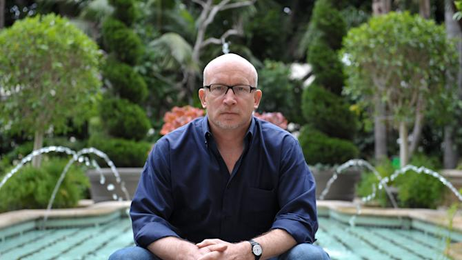 "FILE - In this Wednesday, April 24, 2013 photo, Alex Gibney poses for a portrait at the Four Seasons in Los Angeles. Gibney is the director of the documentary film, ""We Steal Secrets: The Story of WikiLeaks."" The story of WikiLeaks, with its enigmatic leader Julian Assange and recently convicted leaker Bradley Manning, is the kind of real-life drama Hollywood loves, so expect to see multiple interpretations of it on the big screen. (Photo by John Shearer/Invision/AP, File)"