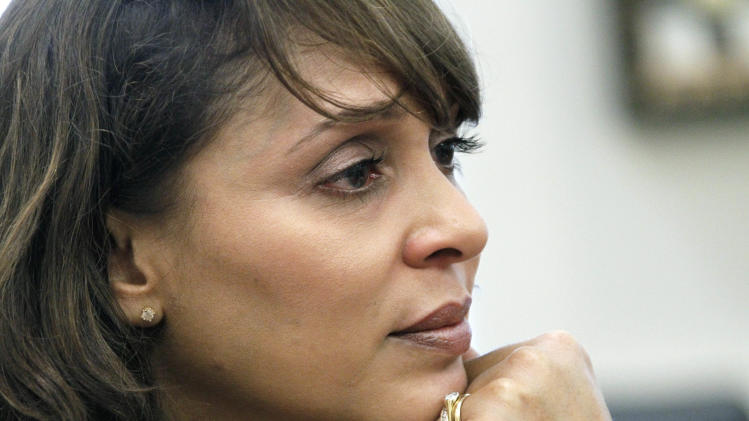 In this Sept. 18, 2012 photograph taken at Delta State University in Cleveland, Miss., U.S. Poet Laureate Natasha Trethewey pauses as she speaks about her mother, Gwendolyn Ann Turnbough, who was killed two decades ago by a stepfather Trethewey always feared. Trethewey hopes in her new capacity to develop  a national discussion on poetry and its relevance to society and place. (AP Photo/Rogelio V. Solis)