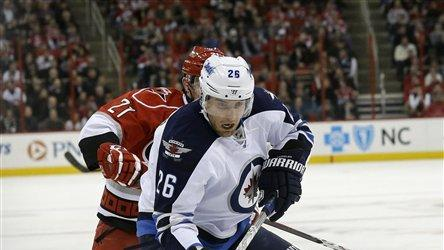 Jets slip past Hurricanes 4-3