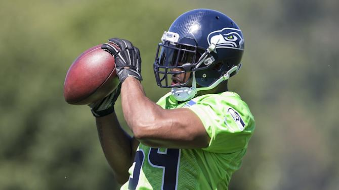 Seattle Seahawks linebacker Bobby Wagner catches a ball in drills during an NFL football training camp on Friday, July 31, 2015, in Renton, Wash. (AP Photo/Stephen Brashear)