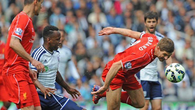 Liverpool's Steven Gerrard, right, heads the ball clear during the English Premier League soccer match between West Bromwich Albion and Liverpool at the Hawthorns, West Bromwich, England, Saturday, April 25, 2015. (AP Photo/Rui Vieira)