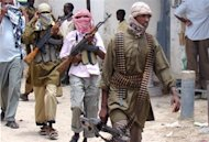 Somali Shebab militia patrols Bakara Market in Mogadishu on October 4, 2009. Somalia's Al-Qaeda-linked Shebab said Monday a French soldier wounded and captured during a failed hostage rescue raid has died and published pictures of the purported commando chief's body
