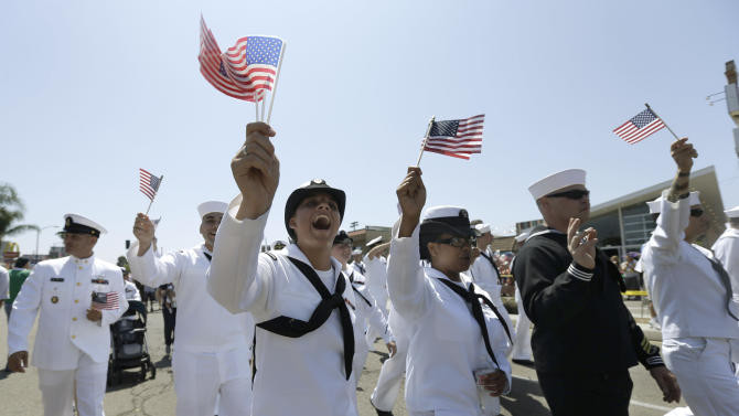 """FILE - In this Saturday, July 21, 2012 file photo, sailors march in uniform during the gay pride parade in San Diego. For the first time ever, U.S. service members had marched in a gay pride event decked out in uniform Saturday, after a recent memorandum from the Defense Department to all military branches made an allowance for the San Diego parade - even though its policy generally bars troops from marching in uniform in parades. On Sept. 20, 2011, the repeal of the policy known as """"don't ask, don't tell"""" took effect, enabling gay and lesbian members of the military to serve openly, no longer forced to lie and keep their personal lives under wraps. One year later, the Pentagon says repeal has gone smoothly, with no adverse effect on morale, recruitment or readiness. Some critics persist with complaints that repeal has infringed on service members whose religious faiths condemn homosexuality. Instances of anti-gay harassment have not ended. And activists are frustrated that gay and lesbian military families don't yet enjoy the benefits and services extended to other military families. Yet the clear consensus is that repeal has produced far more joy and relief than dismay and indignation. (AP Photo/Gregory Bull)"""