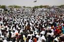 People gather to attend a speech by the Sudanese President during his visit to Eastern Darfur on April 5, 2016, ahead of a referendum on the future of Darfur