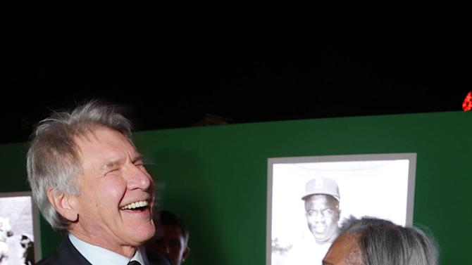 Harrison Ford and Rachel Robinson at The Los Angeles Premiere of Warner Bros. Pictures' and Legendary Pictures' 42, on Tuesday, April, 9th, 2013 in Los Angeles. (Photo by Eric Charbonneau/Invision for Warner Bros./AP Images)