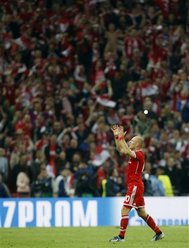 Bayern's Arjen Robben of the Netherlands, gestures, as he celebrates his team winning the Champions League Final against  Borussia Dortmund, at Wembley Stadium in London, Saturday, May 25, 2013