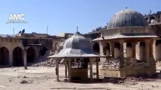 This image taken from video obtained from Aleppo Media Center AMC, which has been authenticated based on its contents and other AP reporting, shows the damaged famed 12th century Umayyad mosque, which was destroyed due to shelling, in the northern city of Aleppo, Syria, Wednesday, April 24, 2013. The minaret of a famed 12th century Sunni mosque in the northern Syrian city of Aleppo was destroyed Wednesday, leaving the once-soaring stone tower a pile of rubble and twisted metal scattered in the tiled courtyard. President Bashar Assad's regime and anti-government activists traded blame for the attack against the Umayyad mosque, which occurred in the heart Aleppo's walled Old City, a UNESCO World Heritage site. It was the second time in just over a week that a historic Sunni mosque in Syria has been seriously damaged. (AP Photo/Aleppo Media Center, AMC)