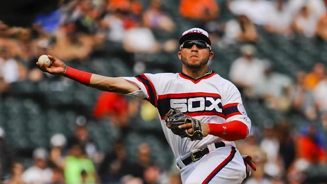 After a fielding error, Chicago White Sox's Carlos Sanchez throws to first during the seventh inning of a baseball game against the Baltimore Orioles in Chicago on Sunday, July 5, 2015. (AP Photo/Matt Marton)