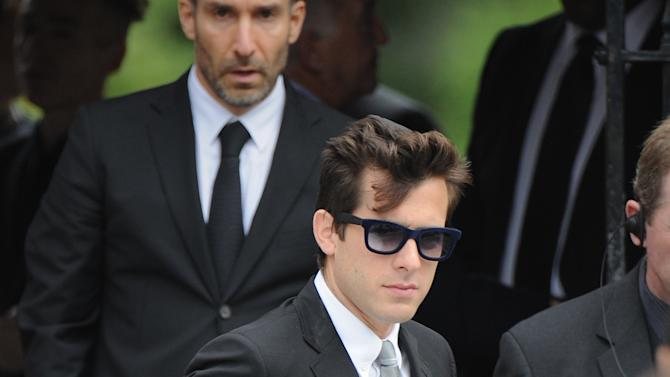 """British musician Mark Ronson, centre, leaves Golders Green,Crematorium after attending the funeral of Amy Winehouse in north London, Tuesday, July 26, 2011 .  The soul diva, who had battled alcohol and drug addiction, was found dead Saturday at her London home. She was 27.  Ronson produced her multi-award winning album """"Back to Black"""". (AP Photo/Joel Ryan)"""