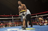 Lamont Peterson knocked down Kendall Holt in the sixth round, on February 22, 2013, before stopping him in the eighth. Peterson showed no ring rust after a 14-month layoff to retain the International Boxing Federation light-welterweight crown