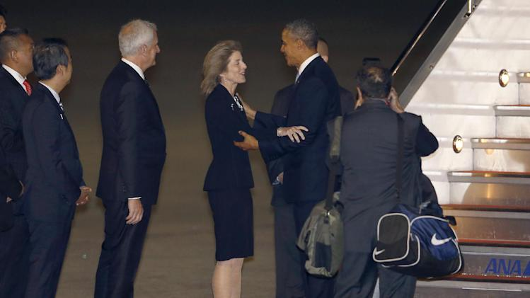 U.S. President Barack Obama is welcomed by U.S. Ambassador to Japan Caroline Kennedy upon his arrival at Haneda International Airport in Tokyo, Wednesday, April 23, 2014. Obama is in Japan for a three-day state visit. (AP Photo/Shizuo Kambayashi)