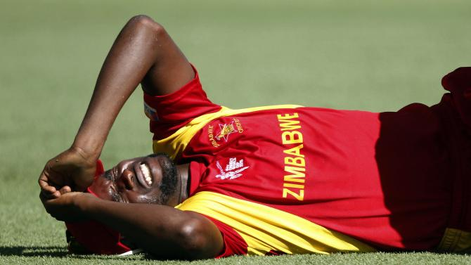 Zimbabwe's Elton Chigumbura injures himself while trying to field a ball during the Cricket World Cup match against Pakistan at the GABBA in Brisbane