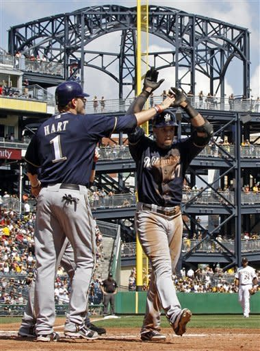 Rogers effective as Brewers beat Pirates 7-0