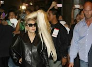 US singer Lady Gaga arrives at a hotel in Makati, financial district of Manila on May 19. Gaga&#39;s Philippine concerts will go ahead as planned, organisers said Sunday, despite a series of protests from Christian groups and calls for the controversial singer to be banned