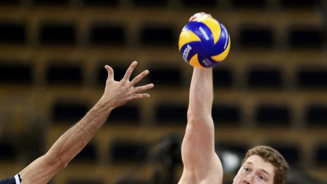 Russia's Muserskiy spikes the ball against Iran during their match at the FIVB Volleyball Men's World Championship Poland 2014 at Atlas Arena  in Lodz