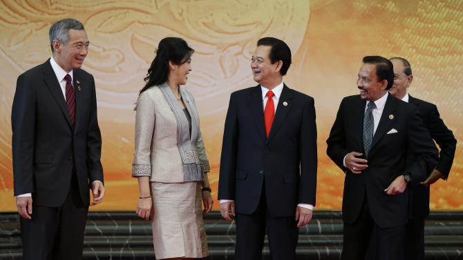 Leaders of the Association of South-East Asian Nations smile each other after a group photo section during the 22nd ASEAN Summit in Bandar Seri Begawan, Brunei, Thursday, April 25, 2013. They are, from left, Singapore's Prime Minister Lee Hsien Loong, Thai Prime Minister Yingluck Shinawatra, Vietnamese Prime Minister Nguyen Tan Dung, Brunei Sultan Hassanal Bolkia and Myanmar's President Thein Sein. (AP Photo/Vincent Thian)