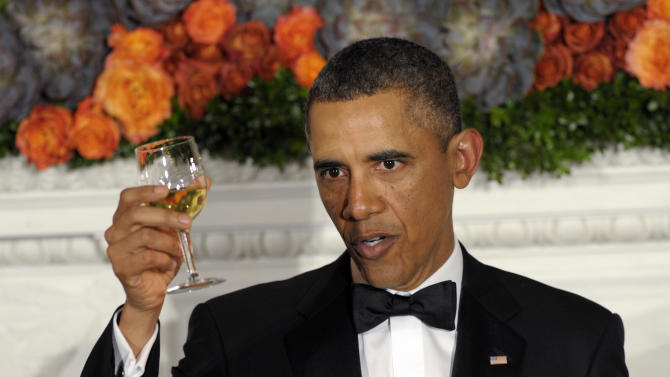 President Barack Obama offers up a toast as he welcomes the governors of the National Governors Association to the 2013 Governors' Dinner at the White House in Washington, Sunday, Feb. 24, 2013. (AP Photo/Susan Walsh)