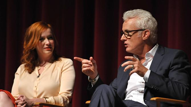 COMMERCIAL IMAGE - In this image provided by AMC, Christina Hendricks and John Slattery appear on stage at the Mad Men screening at the Academy of Television Arts & Sciences on Sunday June 10, 2012 in the North Hollywood section of Los Angeles. (Photo by John Shearer/Invision for AMC/AP Images)