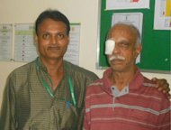 Indian doctor V. Seetharaman (left) is seen with his patient P.K. Krishnamurthy after Seetharaman removed a 13-centimetre live worm from Krishnamurthy&#39;s eye at a hospital in Mumbai this week. Seetharaman said the worm may be a record-breaking size