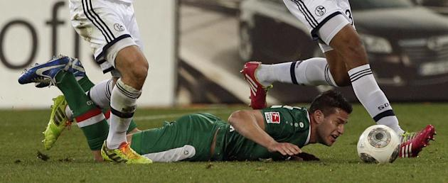 Augsburg's Raul Bobadilla of Argentina lies on the ground during the German first division Bundesliga soccer match between FC Augsburg and FC Schalke 04, in Augsburg, southern Germany, Friday, Mar