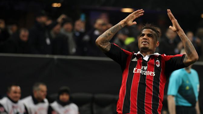 AC Milan's Kevin-Prince Boateng celebrates after scoring during the Champions League round of 16, first leg soccer match against FC Barcelona at the San Siro stadium in Milan, Italy, Wednesday, Feb. 20, 2013. (AP Photo/Felice Calabro')