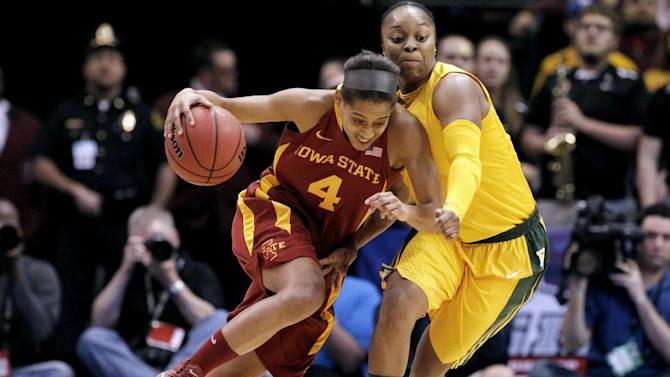 Iowa State guard Nikki Moody (4) drives against Baylor guard Odyssey Sims, right, in the first half of their NCAA college basketball championship game in the Big 12 Conference tournament, Monday, March 11, 2013, in Dallas. (AP Photo/Tony Gutierrez)