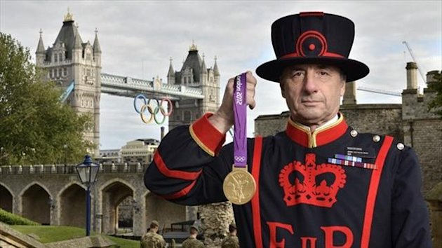 Chief Yeoman Warder Alan Kingshott with an Olympic medal at the Tower of London - image courtesy of London2012.com