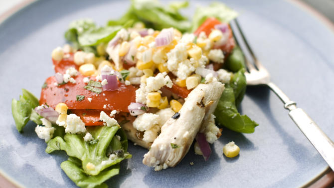 In this image taken on May 20, 2013, grilled Greek chicken salad is shown served on a plate in Concord, N.H. (AP Photo/Matthew Mead)