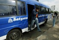 Indian employee of Satyam Computer Services Limited descends from a bus as he arrives for work in Hyderabad in 2009. Indian software outsourcer Mahindra Satyam on Thursday said its quarterly net profit rose 56 percent year-on-year, beating forecasts as orders climbed